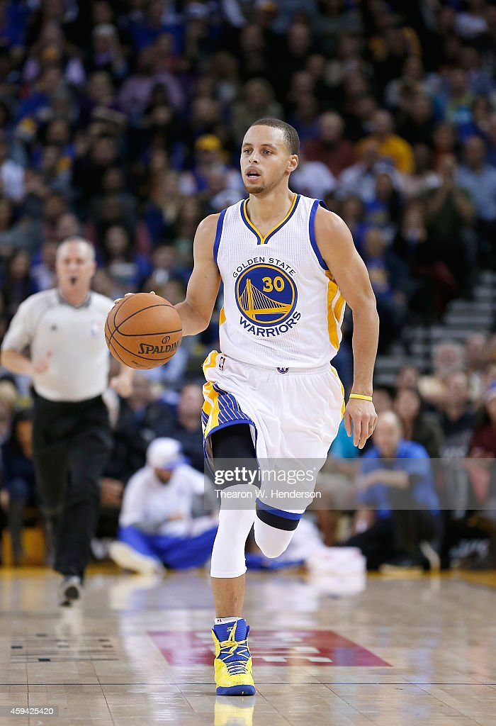 Golden State Warriors guard <a gi-track='captionPersonalityLinkClicked' href=/galleries/search?phrase=Stephen+Curry+-+Basketball+Player&family=editorial&specificpeople=5040623 ng-click='$event.stopPropagation()'>Stephen Curry</a> #30 dribbles the ball up court against the Utah Jazz at ORACLE Arena on November 21, 2014 in Oakland, California.