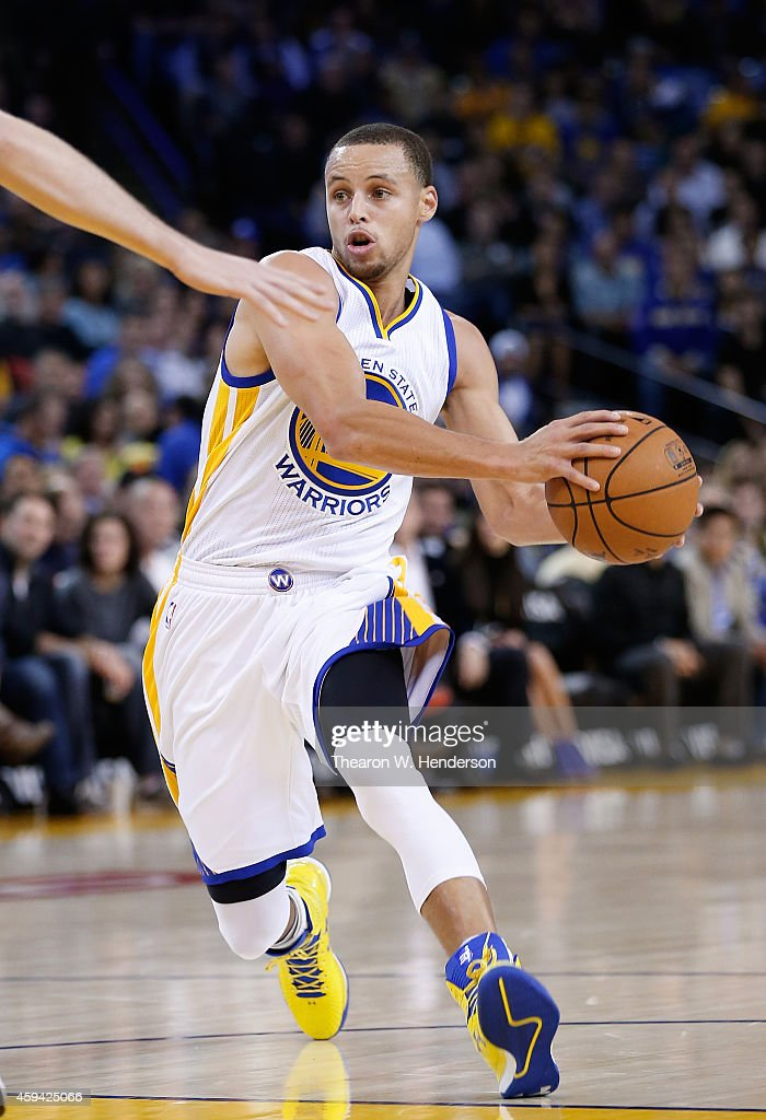 Golden State Warriors guard <a gi-track='captionPersonalityLinkClicked' href=/galleries/search?phrase=Stephen+Curry+-+Basketball+Player&family=editorial&specificpeople=5040623 ng-click='$event.stopPropagation()'>Stephen Curry</a> #30 drives towards the basket against the Utah Jazz at ORACLE Arena on November 21, 2014 in Oakland, California.