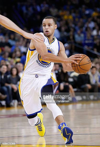 Golden State Warriors guard Stephen Curry drives towards the basket against the Utah Jazz at ORACLE Arena on November 21 2014 in Oakland California