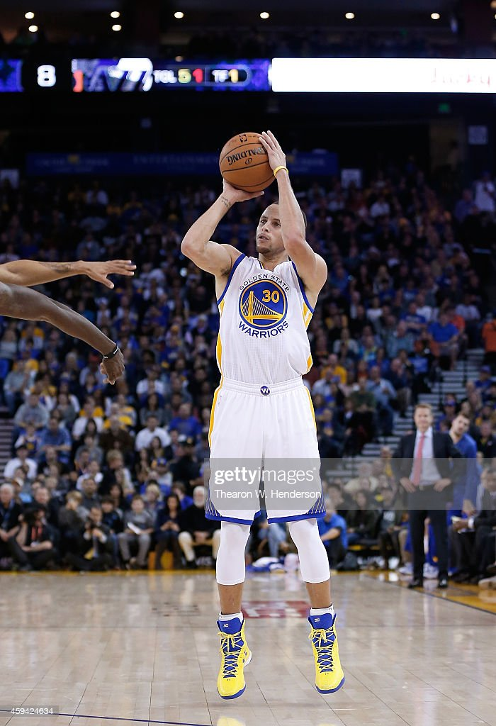 Golden State Warriors guard <a gi-track='captionPersonalityLinkClicked' href=/galleries/search?phrase=Stephen+Curry+-+Basketball+Player&family=editorial&specificpeople=5040623 ng-click='$event.stopPropagation()'>Stephen Curry</a> #30 goes up to shoot against the Utah Jazz at ORACLE Arena on November 21, 2014 in Oakland, California.