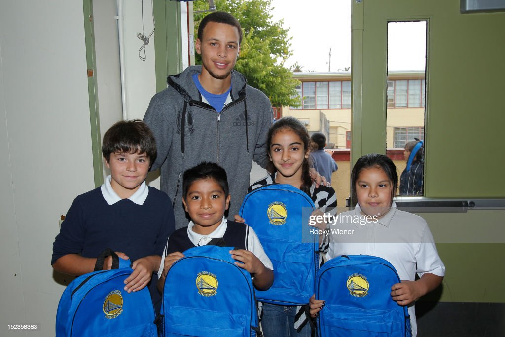 Golden State Warriors guard Stephen Curry poses with students at Garfield Elementary on September 17, 2012 in Oakland, California.