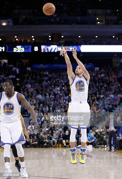 Golden State Warriors guard Stephen Curry shoots against the Utah Jazz at ORACLE Arena on November 21 2014 in Oakland California