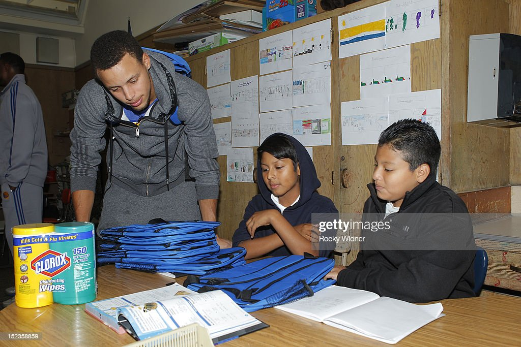 Golden State Warriors guard Stephen Curry visits with students at Garfield Elementary on September 17, 2012 in Oakland, California.