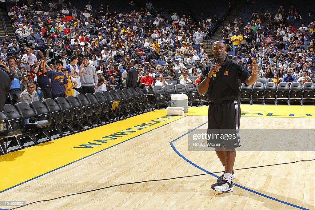 Golden State Warriors Head Coach Keith Smart speaks to fans at the team's annual Open Practice on October 6, 2010 in Oakland, California.