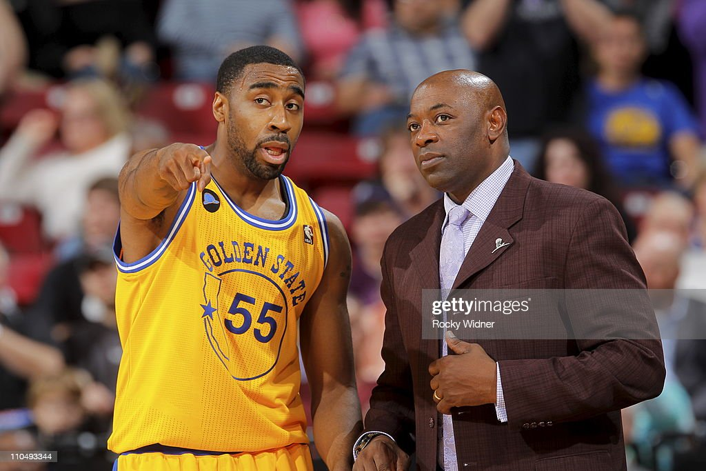 Golden State Warriors head coach Keith Smart talks with guard Reggie Williams during a break in action against the Sacramento Kings on March 14 2011...