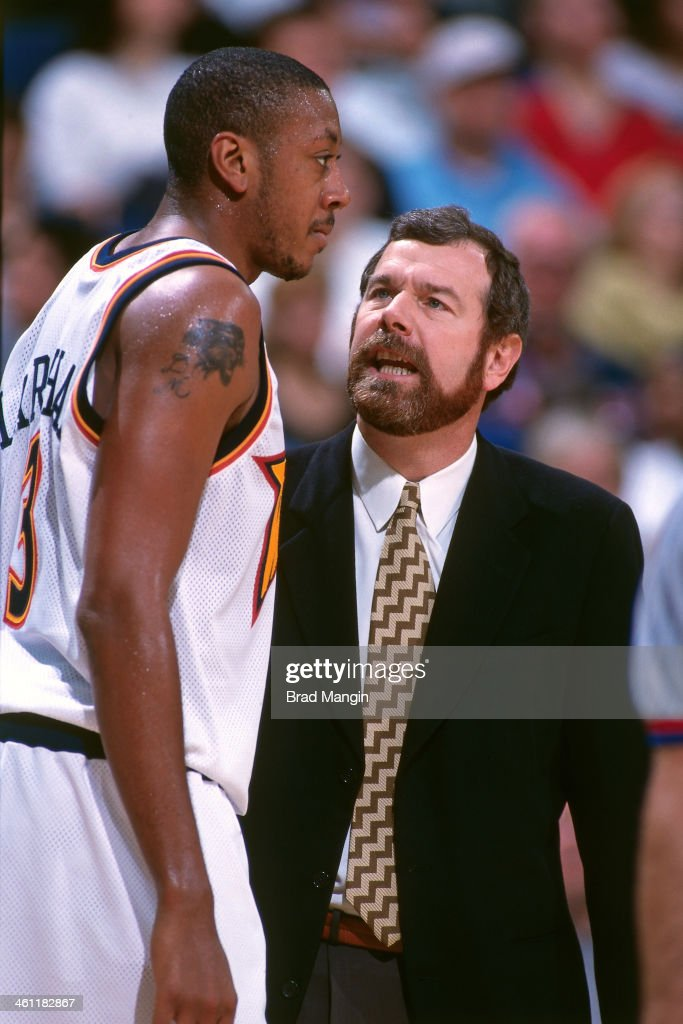 Golden State Warriors head coach PJ Carlesimo and Donyell Marshall talk circa 1998 at the Arena in Oakland in Oakland California NOTE TO USER User...