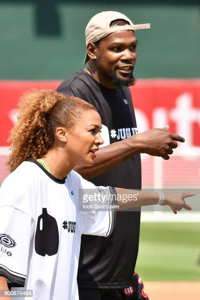 Golden State Warriors Kevin Durant and Ros Gold Onwude talk trash to each other during JaVale McGees JUGLIFE charity softball game on June 24 at...