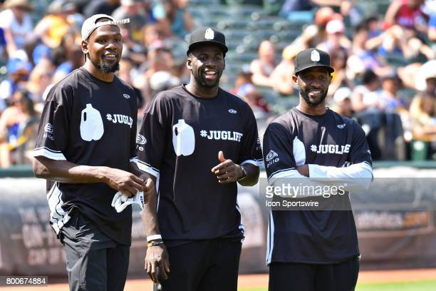 Golden State Warriors Kevin Durant Draymond Green and Ian Clark look on during JaVale McGees JUGLIFE charity softball game on June 24 at...