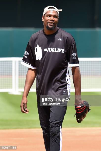 Golden State Warriors Kevin Durant in the field looks on during JaVale McGees JUGLIFE charity softball game on June 24 at OaklandAlameda County...