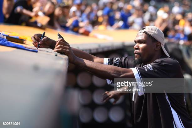 Golden State Warriors Kevin Durant signs autographs during JaVale McGees JUGLIFE charity softball game on June 24 at OaklandAlameda County Coliseum...