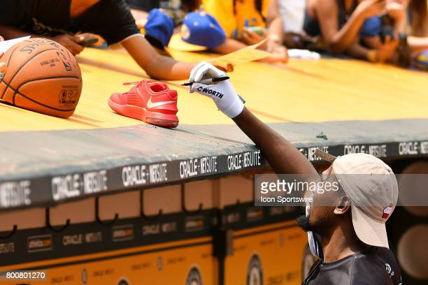 Golden State Warriors Kevin Durant signs autographs with his cupcake hat with a ring on it during JaVale McGees JUGLIFE charity softball game on June...
