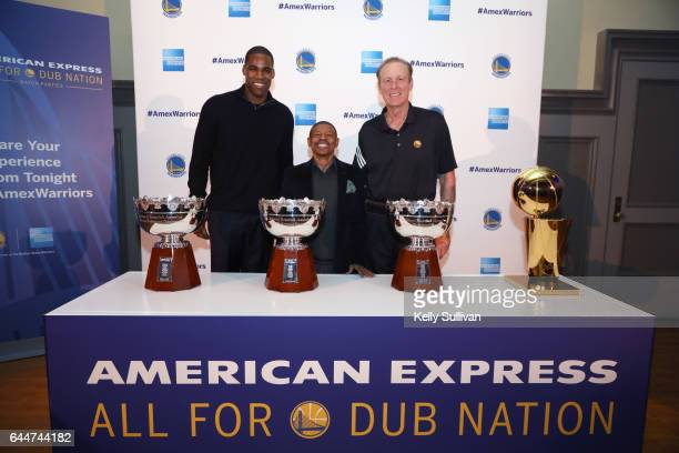 Golden State Warriors legends Antawn Jamison Muggsy Bogues and Rick Barry pose for a photo with NBA Championship Trophies during the American Express...