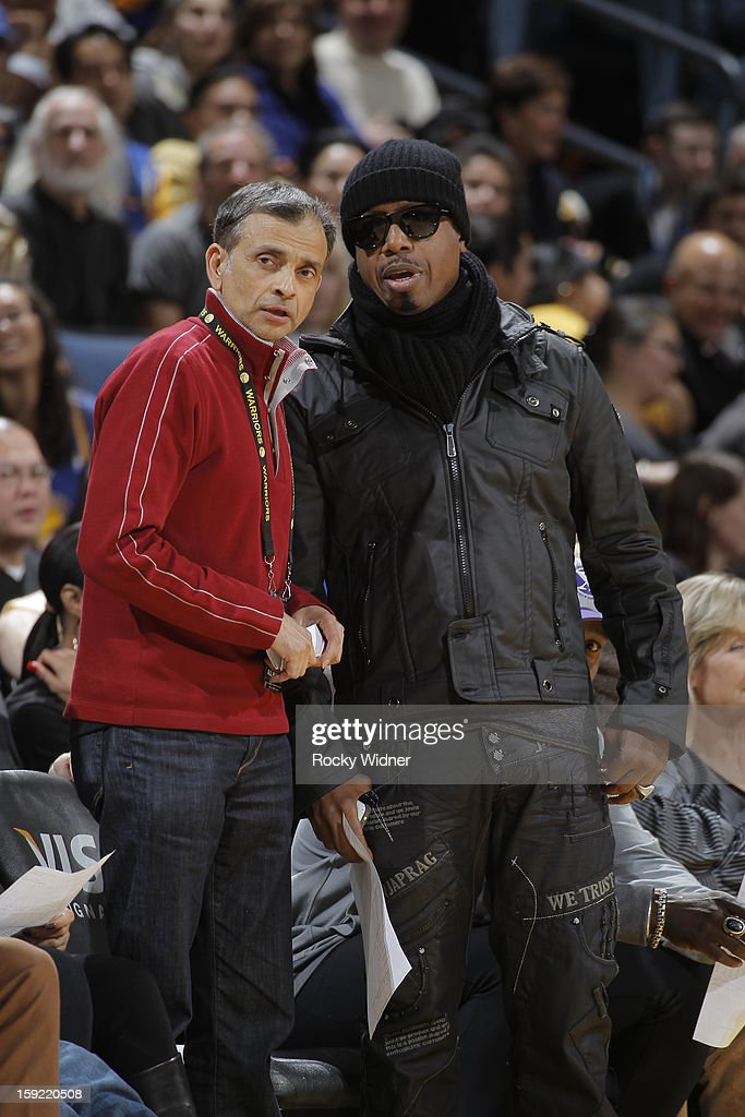 Golden State Warriors owner Vivek Ranadive chats with MC Hammer during a game between the Memphis Grizzlies and the Golden State Warriors on January 9, 2013 at Oracle Arena in Oakland, California.