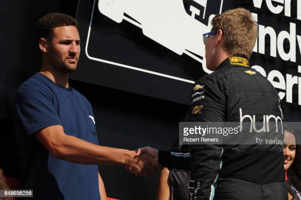 Golden State Warriors player Klay Thompson greets Josef Newgarden driver of the hum by Verizon Chevrolet prior to the Verizon IndyCar Series GoPro...