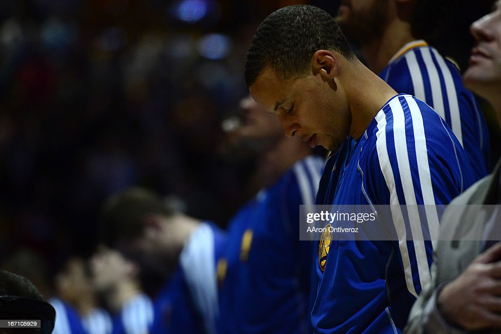 Golden State Warriors point guard Stephen Curry (30) bows his head during the National anthem before the start of the game. The Denver Nuggets took on the Golden State Warriors in Game 1 of the Western Conference First Round Series at the Pepsi Center in Denver, Colo. on April 20, 2013.