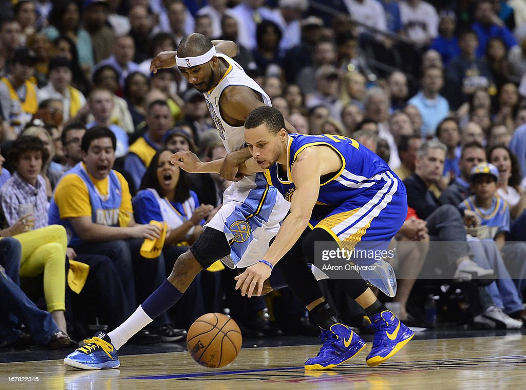 Golden State Warriors point guard Stephen Curry (30) chases down a loose ball against Denver Nuggets small forward Corey Brewer (13). The Denver Nuggets took on the Golden State Warriors in Game 5 of the Western Conference First Round Series at the Pepsi Center in Denver, Colo. on April 30, 2013.