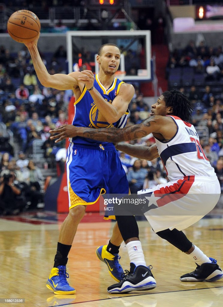 Golden State Warriors point guard Stephen Curry (30) dishes off the ball against Washington Wizards power forward Cartier Martin (20) in the second quarter at the Verizon Center in Washington, D.C., Saturday, December 8, 2012.