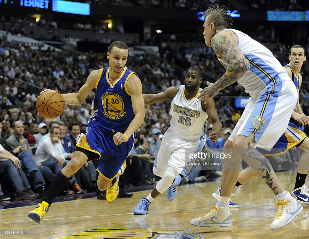 Golden State Warriors point guard Stephen Curry (30) drives on Denver Nuggets point guard Raymond Felton (20) and center Chris Andersen (11) during the first half on Monday, Aril 11, 2011 at the Pepsi Center. AAron Ontiveroz, The Denver Post