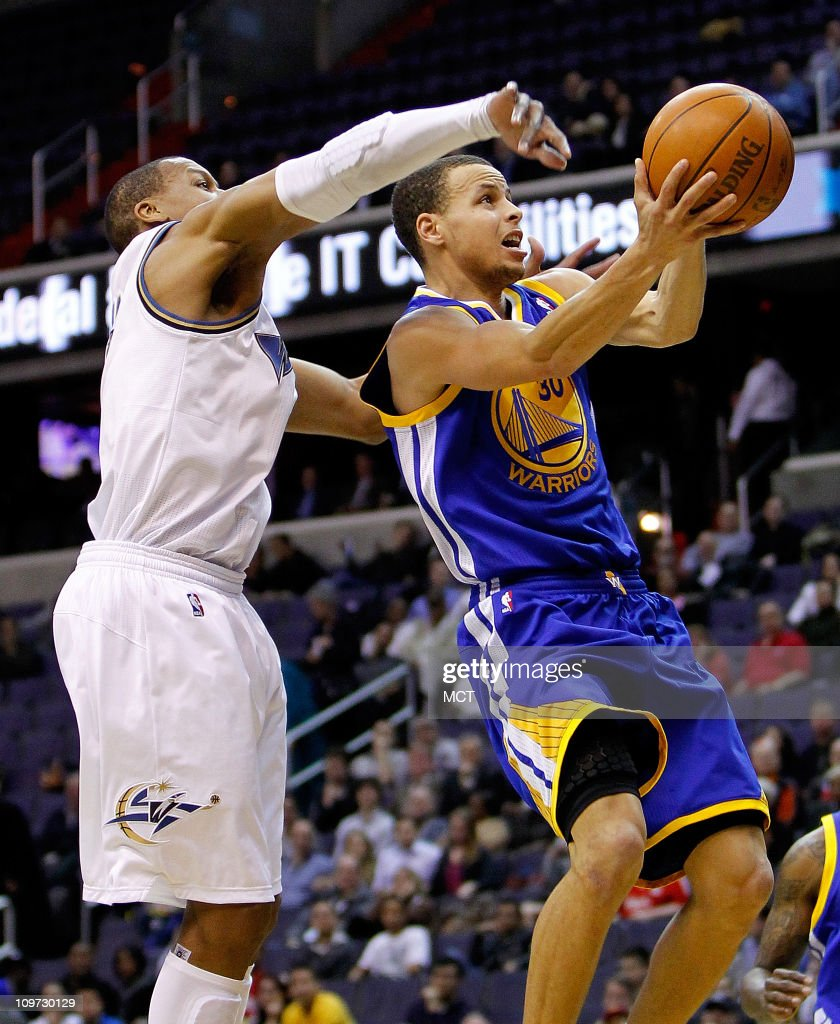 Golden State Warriors point guard Stephen Curry (30) drives past Washington Wizards small forward Maurice Evans (6) for a score during their game played at the Verizon Center in Washington, D.C., Wednesday, March 2, 2011.
