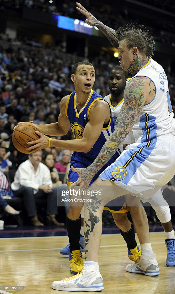 Golden State Warriors point guard Stephen Curry (30) is defended tightly by Denver Nuggets center Chris Andersen (11) during the first half on Monday, Aril 11, 2011 at the Pepsi Center. AAron Ontiveroz, The Denver Post