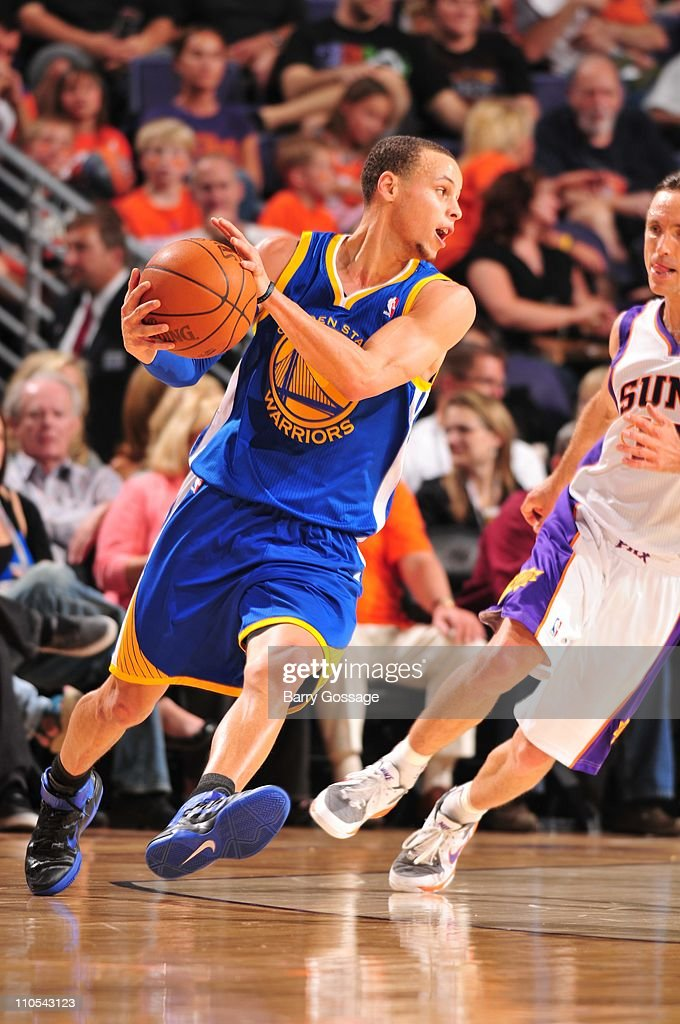 Golden State Warriors point guard Stephen Curry #30 protects the ball during the game against the Phoenix Suns March 18, 2011 at U.S. Airways Center in Phoenix, Arizona. The Suns won 108-97.