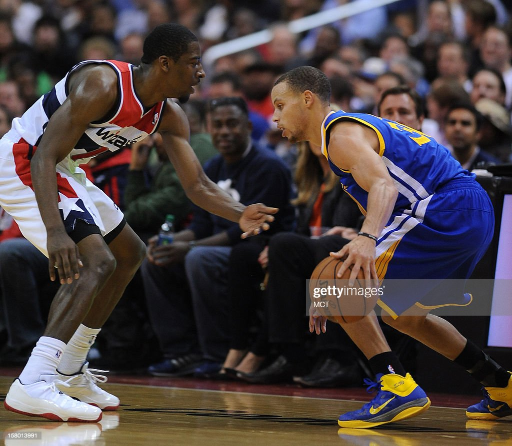 Golden State Warriors point guard Stephen Curry (30) right, works his dribble against Washington Wizards shooting guard Jordan Crawford (15) in the third quarter at the Verizon Center in Washington, D.C., Saturday, December 8, 2012. The Warriors defeated the Wizards, 101-97.