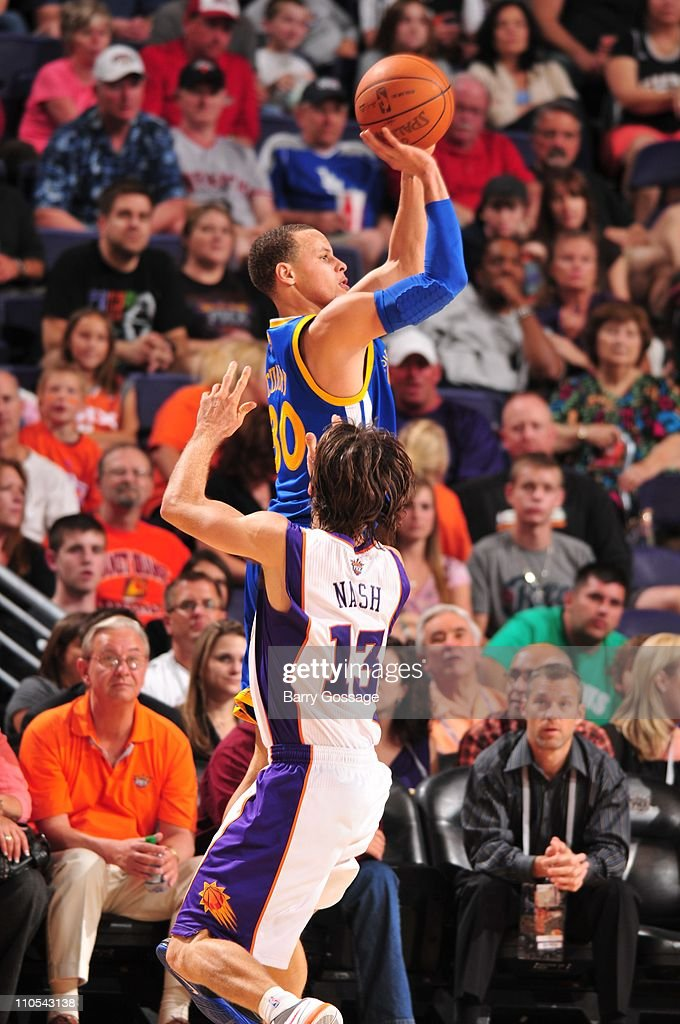 Golden State Warriors point guard Stephen Curry #30 shoots the ball under pressure during the game against the Phoenix Suns March 18, 2011 at U.S. Airways Center in Phoenix, Arizona. The Suns won 108-97.