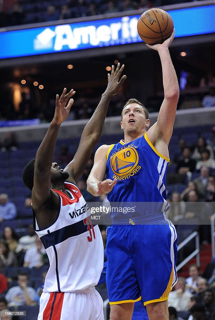 Golden State Warriors power forward David Lee (10) shoots and scores over Washington Wizards small forward Chris Singleton (31) in the first quarter at the Verizon Center in Washington, D.C., Saturday, December 8, 2012.