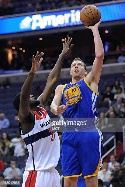 Golden State Warriors power forward David Lee shoots and scores over Washington Wizards small forward Chris Singleton in the first quarter at the...