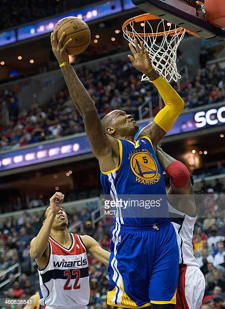 Golden State Warriors power forward Marreese Speights scores over Washington Wizards power forward Nene Hilario during the first half of their game...