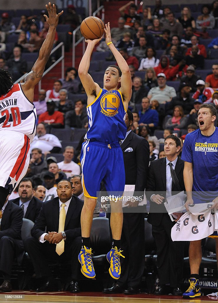 Golden State Warriors shooting guard Klay Thompson (11) hits a jumper over Washington Wizards power forward Cartier Martin (20) in the second quarter at the Verizon Center in Washington, D.C., Saturday, December 8, 2012.
