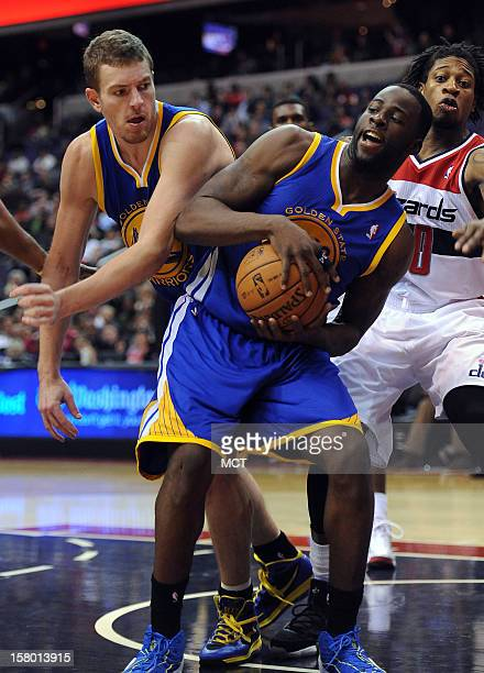 Golden State Warriors small forward Draymond Green and Warriors power forward David Lee left go after a rebound against the Washington Wizards in the...