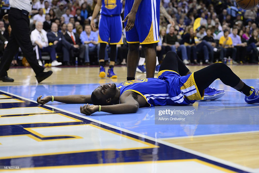 Golden State Warriors small forward Draymond Green (23) is slow to get up in the third quarter. The Denver Nuggets took on the Golden State Warriors in Game 5 of the Western Conference First Round Series at the Pepsi Center in Denver, Colo. on April 30, 2013.