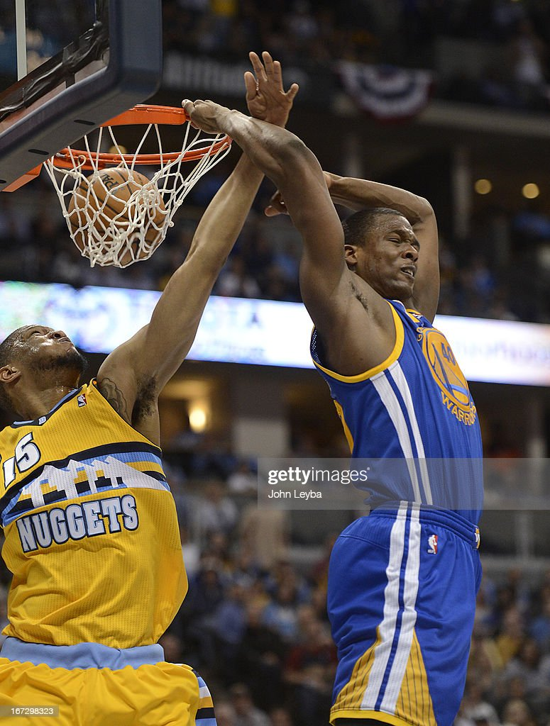Golden State Warriors small forward Harrison Barnes (40) dunks the ball behind his head against Denver Nuggets power forward Anthony Randolph (15) in the third quarter. The Denver Nuggets took on the Golden State Warriors in Game 2 of the Western Conference First Round Series at the Pepsi Center in Denver, Colo. on April 23, 2013.