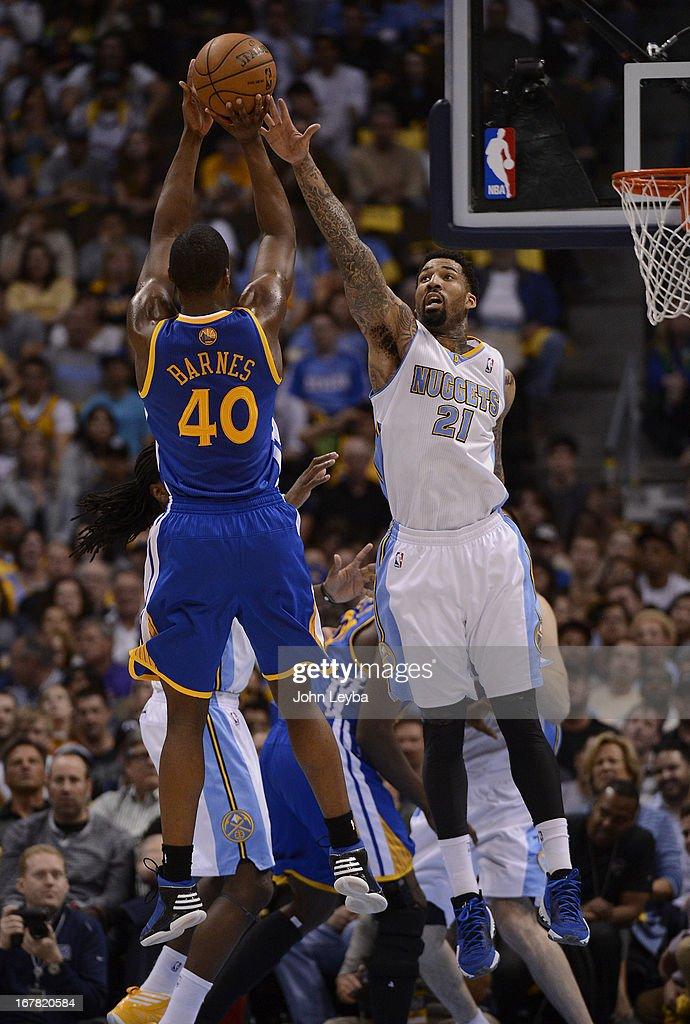 Golden State Warriors small forward Harrison Barnes (40) puts up a shot over Denver Nuggets shooting guard Wilson Chandler (21) in the second quarter. The Denver Nuggets took on the Golden State Warriors in Game 5 of the Western Conference First Round Series at the Pepsi Center in Denver, Colo. on April 30, 2013.
