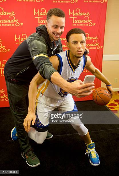 Golden State Warriors' Stephen Curry takes a selfie with his wax figure made by Madame Tussauds San Francisco located on Fisherman's Warf on March 24...
