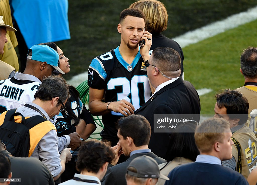 Golden State Warriors Stephen Curry talks on his phone prior to the start of the game. The Denver Broncos played the Carolina Panthers in Super Bowl 50 at Levi's Stadium in Santa Clara, Calif. on February 7, 2016.