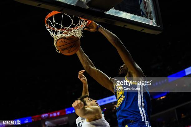 Golden State Warriors's NBA player Kevin Durant slam dunks during the NBA Basketball Game between Golden State Warriors and Minnesota Timberwolves in...