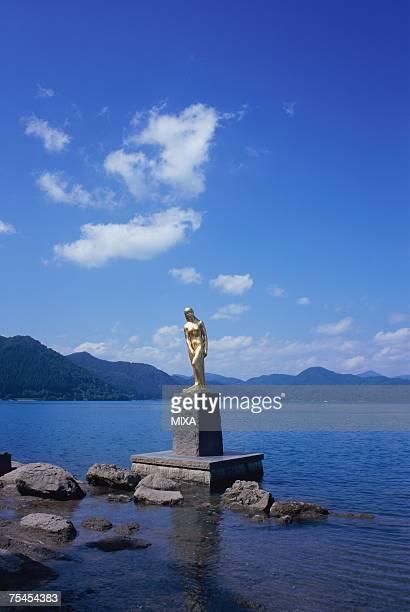 Golden statue at Lake Tazawa in Aomori Prefecture, Japan