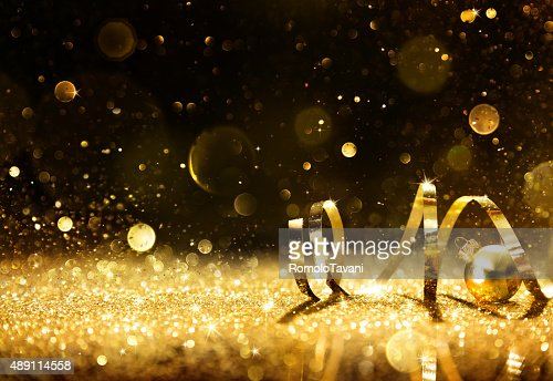 Golden streamers with sparkling glitter : Stock Photo