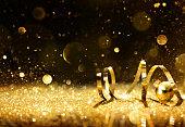 Golden ribbon on shining glitter - christmas background