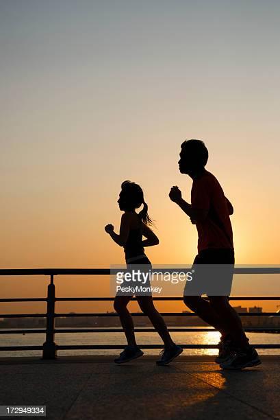 Golden Sun paar Jogging-Silhouette