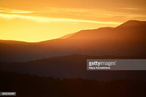 Golden sunrise in mountains