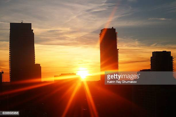 Golden Sunset and City Silhouettes