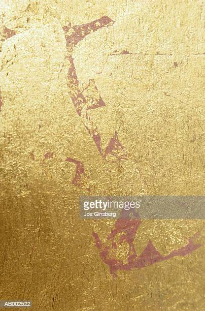Golden Surface with Red Paint