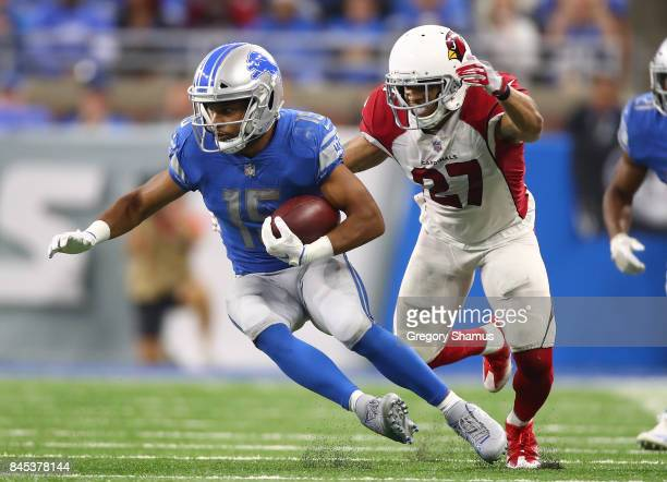 Golden Tate of the Detroit Lions battles for extra yards after a fourth quarter catch in front of Tyvon Branch of the Arizona Cardinals at Ford Field...