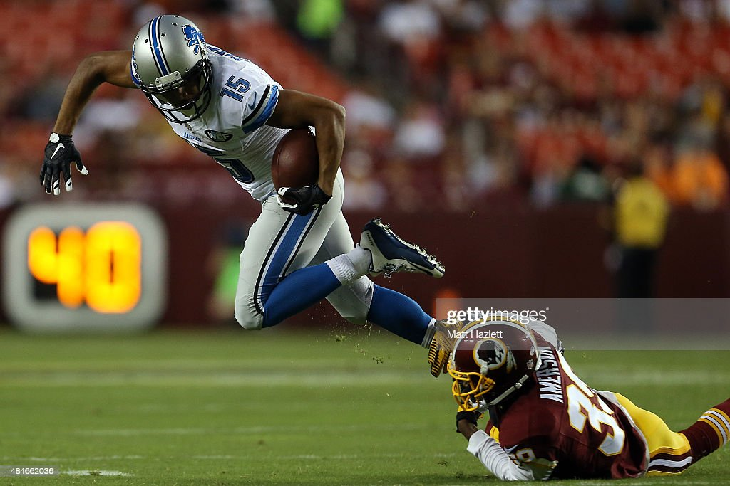 Golden Tate #15 of the Detroit Lions breaks a tackle by David Amerson #39 of the Washington Redskins during a preseason game at FedEx Field on August 20, 2015 in Landover, Maryland.