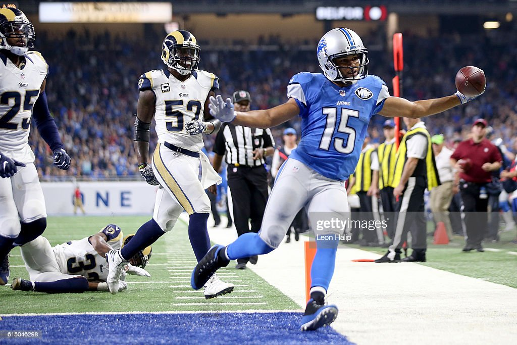 Golden Tate #15 of the Detroit Lions holds out the football after scoring a touchdown during fourth quarter action against the Los Angeles Rams at Ford Field on October 16, 2016 in Detroit, Michigan. The Detroit Lions defeated the Los Angeles Rams 31-28.