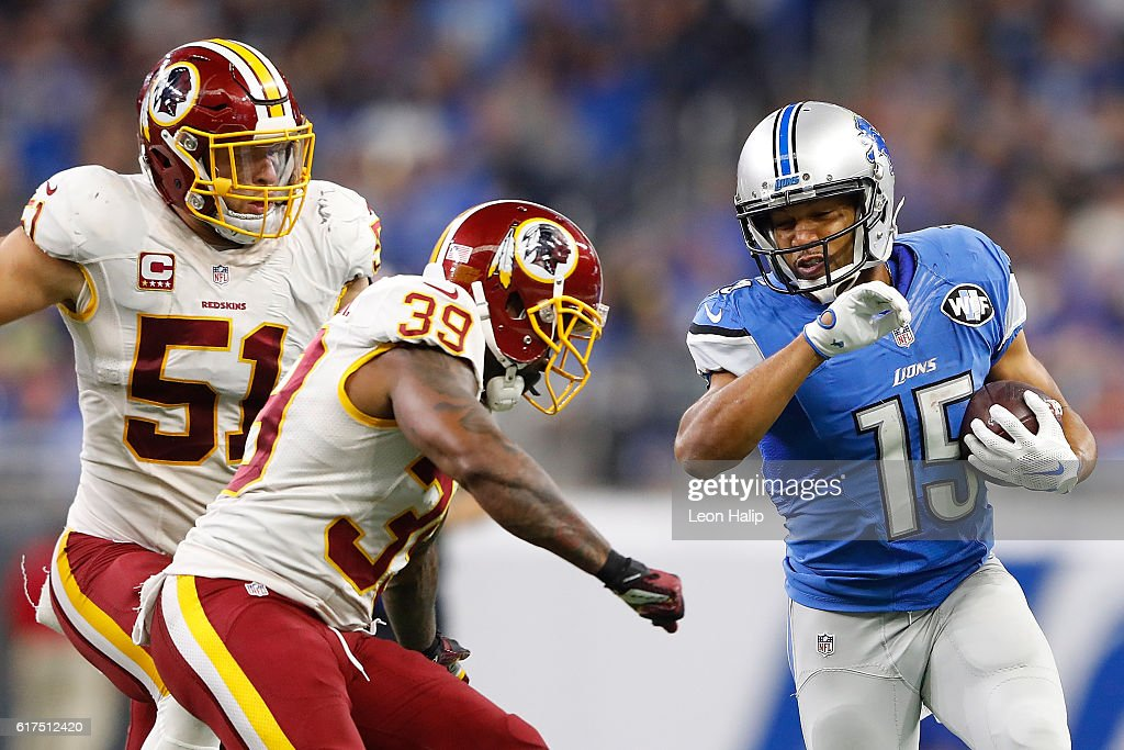 Golden Tate #15 of the Detroit Lions runs for a first down late in the third quarter of the game as Keith Marshall #39 of the Washington Redskins makes the stop at Ford Field on October 23, 2016 in Detroit, Michigan. Detroit defeated Washington 20-17.