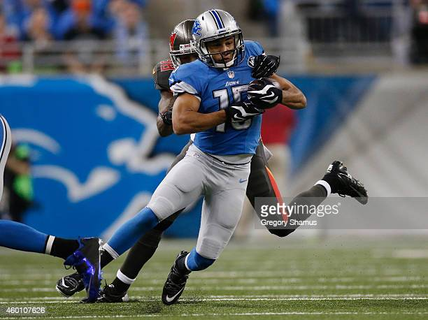 Golden Tate of the Detroit Lions tries to avoid the tackle by Dashon Goldson of the Tampa Bay Buccaneers in the first quarter at Ford Field on...